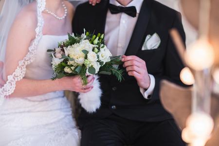 Foto für Beautiful winter wedding bouquet. Bridal bouquet with cones, cotton and spruce branches. The bride holds a wedding bouquet next to the groom. - Lizenzfreies Bild