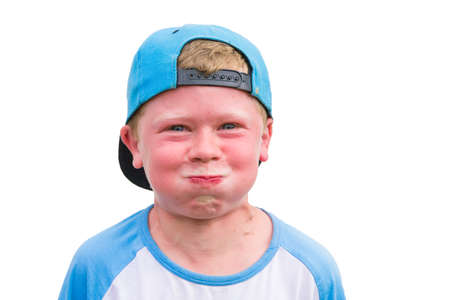 Small angry child boy try to hold breath getting red isolated on white background