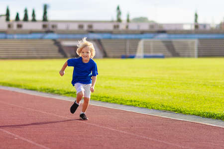 Foto für Child running in stadium. Kids run on outdoor track. Healthy sport activity for children. Little boy at athletics competition race. Young athlete in training. Runner exercising. Jogging for kid. - Lizenzfreies Bild