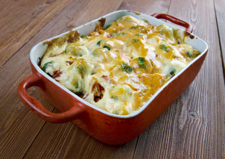 Homemade Chicken Divan - chicken casserole served with almonds, and Mornay sauce