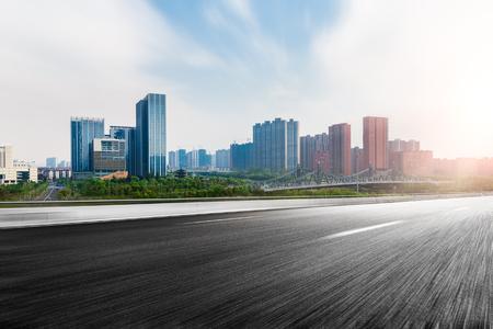 Foto de The city and the road in the modern office building background - Imagen libre de derechos