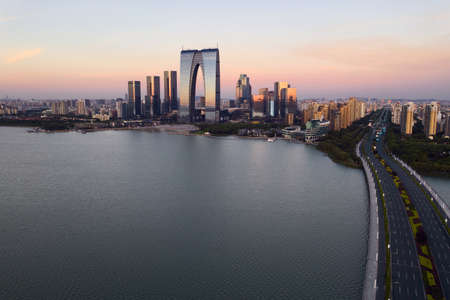 Photo for CBD buildings by the lake. Photo in Suzhou, China. - Royalty Free Image