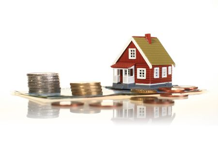 Little house and european money isolated over white.