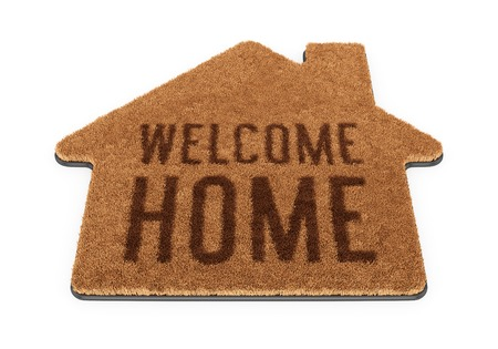 Brown house shape coir doormat with text Welcome Home isolated on white background