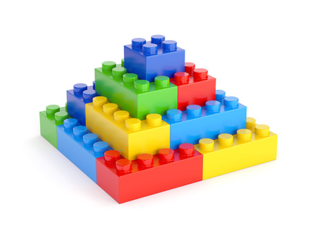 Photo pour Pyramid made of plastic toy blocks isolated on white background - image libre de droit
