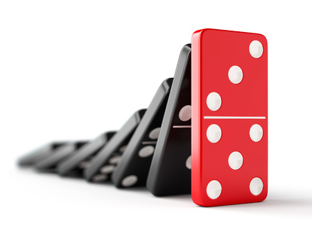 Foto de Unique red domino tile stops falling black dominoes. Leadership, teamwork and business strategy concept. - Imagen libre de derechos