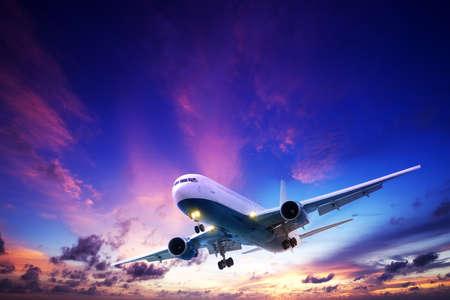 Jet aircraft cruising in a sunset sky