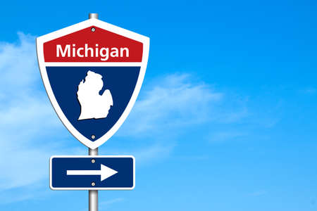 Photo pour Road trip to Michigan, Red, white and blue interstate highway road sign with word Michigan and map of Michiganwith sky background - image libre de droit