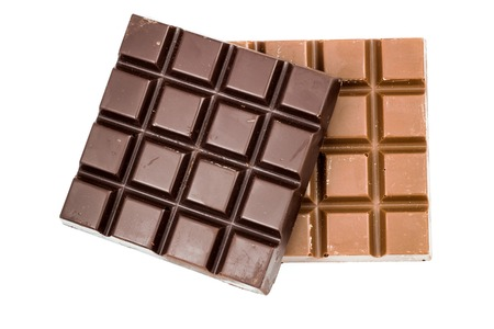 Natural black and milky chocolate bars isolated on white background, top view