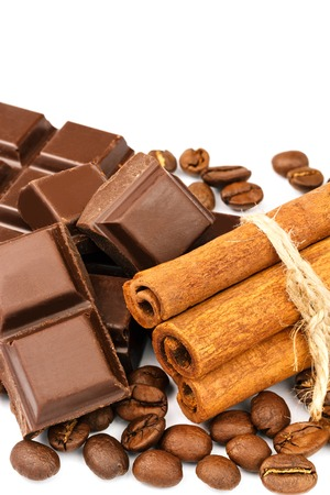 Dark chocolate bar, cubes, cinnamon sticks and coffee beans isolated on white background