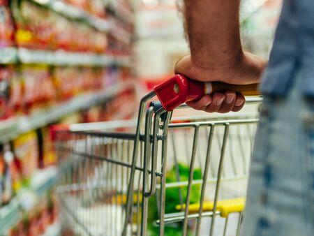 Foto für shopping trolley in supermarket aisle, copy space - Lizenzfreies Bild