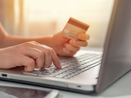 Photo for Online shopping concept. Close-up womans hands holding credit card and using laptop keyboard for online shopping - Royalty Free Image