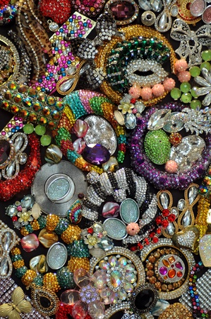 Various jewellery fashion accessories as background