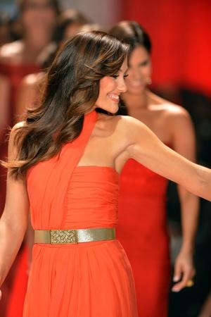 NEW YORK, NY - FEBRUARY 06: Minka Kelly wearing Oscar de la Renta walks the runway at The Heart Truth