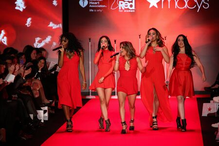 NEW YORK, NY - FEBRUARY 12: Fifth Harmony performs on the runway at the Go Red For Women Red Dress Collection 2015 presented by Macy's fashion show during MBFW Fall 2015 at Lincoln Center on February 12, 2015 in NYC