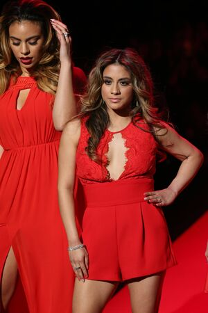 NEW YORK, NY - FEBRUARY 12: Dinah Jane Hansen and Ally Brooke (r) of Fifth Harmony walks the runway at the Go Red For Women Red Dress Collection 2015 show during MBFW Fall 2015 at Lincoln Center on February 12, 2015 in NYC