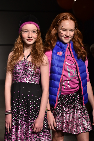 Foto per NEW YORK, NY - OCTOBER 17: Models walk runway at Little Miss Matched Fall/Winter 2016 Runway Show during petiteParade at The Spring Studio on October 17, 2015 in NYC. - Immagine Royalty Free