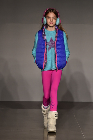 Foto per NEW YORK, NY - OCTOBER 17: A model walks runway at Little Miss Matched Fall/Winter 2016 Runway Show during petiteParade at The Spring Studio on October 17, 2015 in NYC. - Immagine Royalty Free