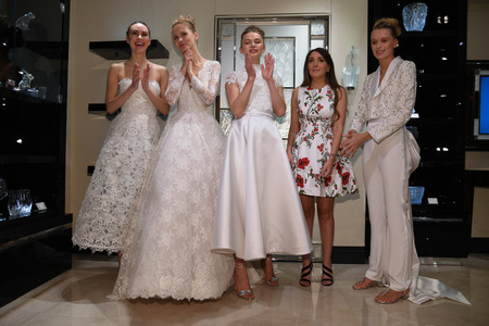 Photo pour NEW YORK, NY - APRIL 10: Designer Gracy Accad and Models posing for photographers  during the Gracy Accad Spring 2020 bridal presentation at Blumingdales store on April 10, 2019 in NYC. - image libre de droit