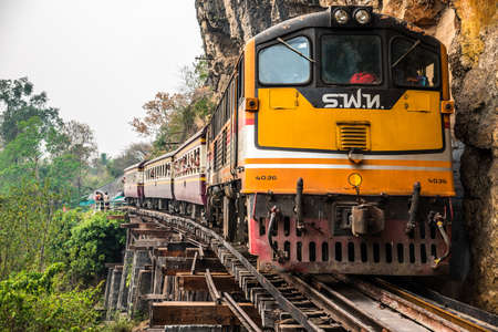 BAN PONG THAILAND- MARCH 12 : The train with unidentified tourists run on Death Railway on March 12, 2016 at Death Railway.