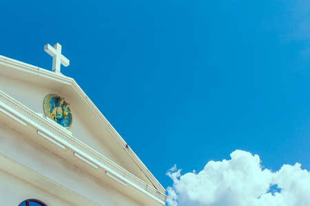 big white cross on blue sky