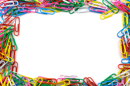 Colorful paperclips isolated on white background
