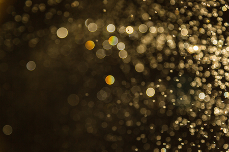 Photo pour Golden Vintage blur bokeh defocused on black background - image libre de droit