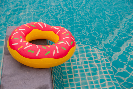 Rubber ring in blue swimming pool background