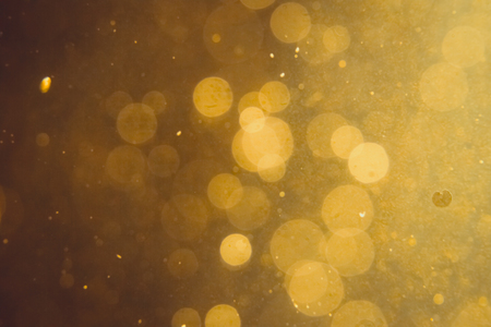 Photo for Dark Abstract Gold bokeh sparkle on black background - Royalty Free Image