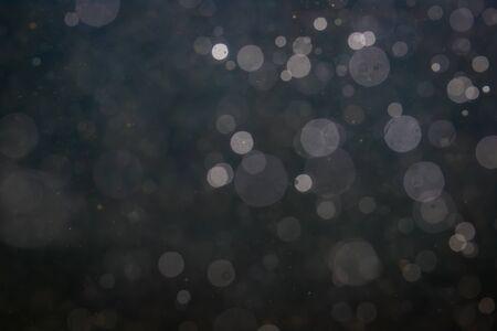 Foto de Fantasy bokeh sparkle from light on black background - Imagen libre de derechos