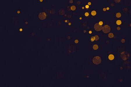 Photo pour Fantasy gold bokeh sparkle from light on black background - image libre de droit
