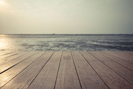 Photo for Vintage  wood floor extends into the sea when the water drops - Royalty Free Image