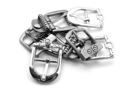 Old buckles on white background