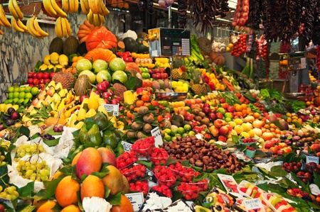 Colourful fruit and vegetable market stall in Boqueria market in Barcelona.