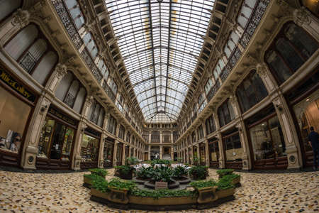 Turin, Italy - June 5, 2016: Interiors of Galleria Subalpina, historical commercial mall in the centre of Torino (Turin), Italy. Fisheye view, scenic distortion.