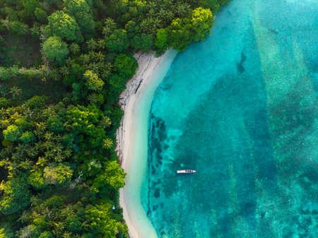 Photo pour Aerial top down view tropical paradise pristine beach rainforest blue lagoon at Banda Island, Pulau Ay. Indonesia Moluccas archipelago, top travel destination, best diving snorkeling. - image libre de droit