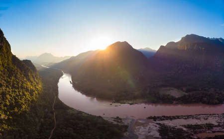 Photo for Aerial panoramic Nam Ou River Nong Khiaw Muang Ngoi Laos, sunset dramatic sky, scenic mountain landscape, famous travel destination in South East Asia - Royalty Free Image