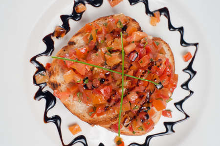 Italian bruschetta with tomato pieces. Downward view.