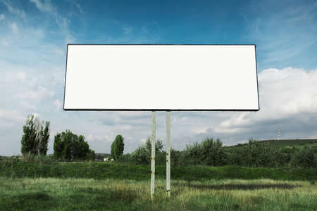 Photo for Empty billboard for advertising poster in green field omn background of blue sky. - Royalty Free Image
