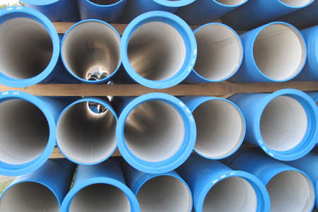 piles of concrete pipes for transporting water and sewerage