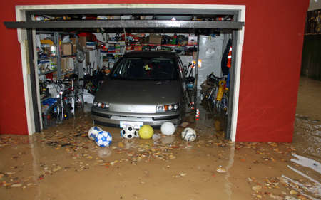 car in the garage of the House submerged by flood mud after the flooding of the River