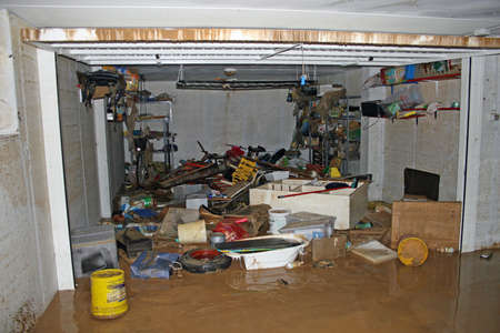 bicycle parts tool and  boxes inside the garage after the flood and river flooding