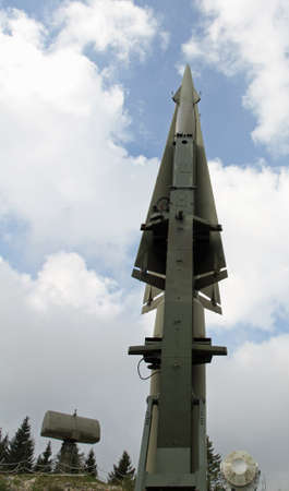 rocket military ready to go from the launching pad and two big radar for remote commands