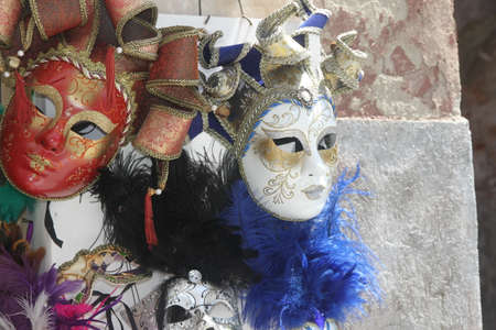 beautiful original Venetian masks handmade in a stand in piazza san marco