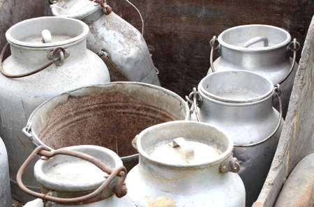 old aluminum containers to carry the fresh milk on farms