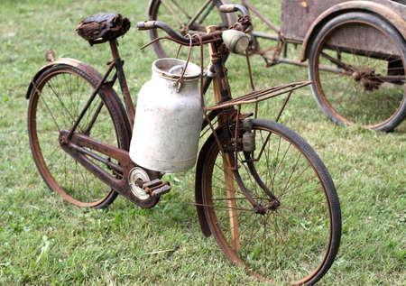 rusty old bikes of ancient milkman with aluminium drum