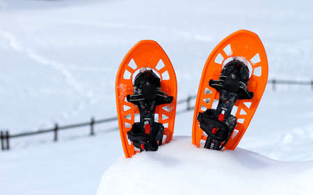 Orange snowshoes for walking on the snow on the mountain in winter