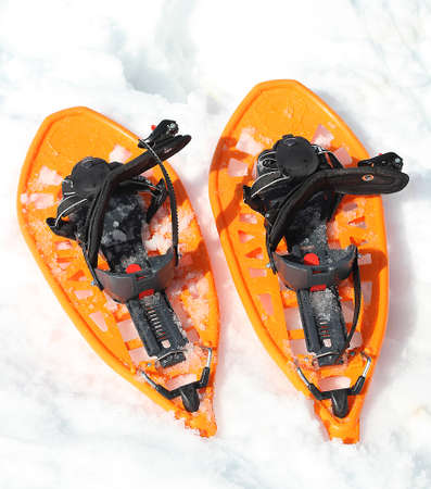 Orange snowshoes for walking on the soft snow on the high mountain in winter