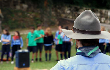 Chief scout with the typical Hat while controlling their kids to camp