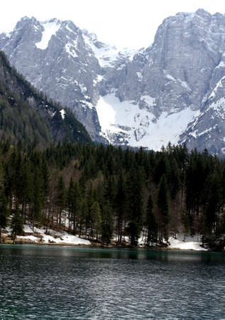 Fantastic Alpine Lake with clear water and the mountains in the background 4